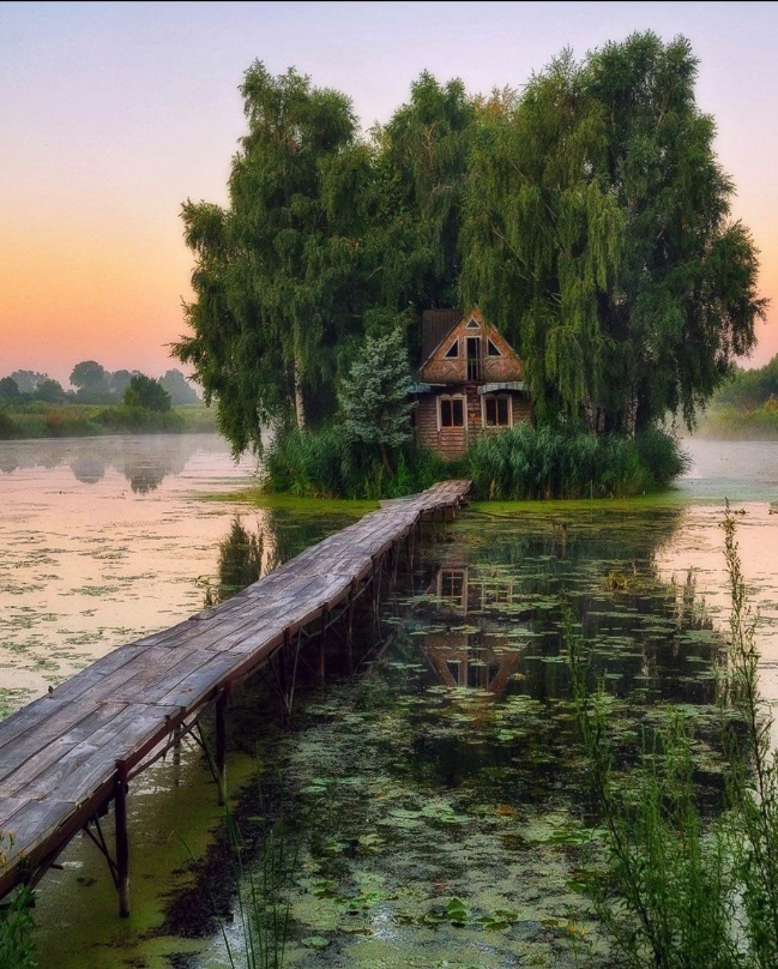 Fairy-tale house in the middle of the lake near Kyiv, Ukraine